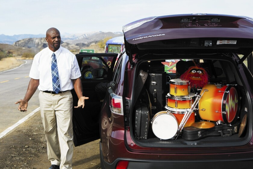 """Actor Terry Crews and the Muppets shoot Toyota's 2014 Highlander commercial that will air during the Super Bowl. The 60-second ad, called """"Joyride,"""" doubles as a promotion for the upcoming Disney movie """"Muppets Most Wanted."""""""