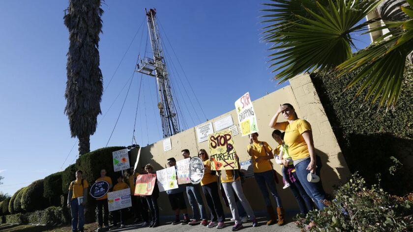 LOS ANGELES-ME- November 18, 2015- Community activists protest at Jefferson Boulevard drilling site