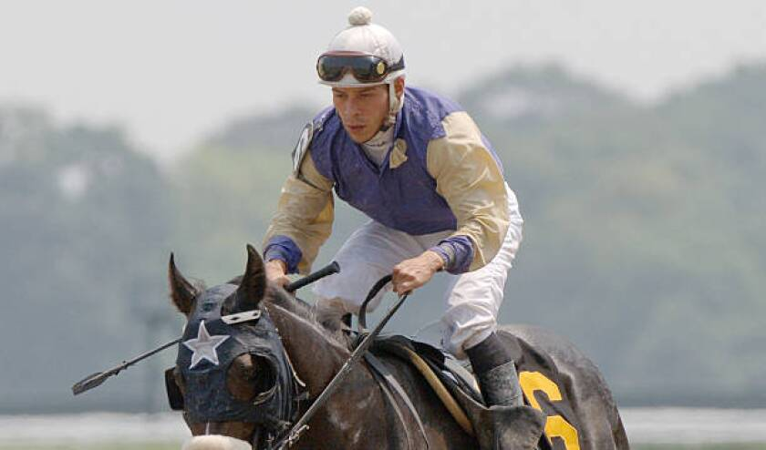 Jockey Norberto Arroyo Jr. rides Ace's Cappella in the first race at 2005 Belmont Stakes.