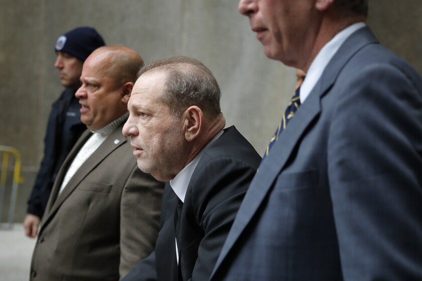 Harvey Weinstein, third from left, leaves court in New York, Monday, Jan. 6, 2020. The disgraced movie mogul faces allegations of rape and sexual assault. (AP Photo/Seth Wenig)