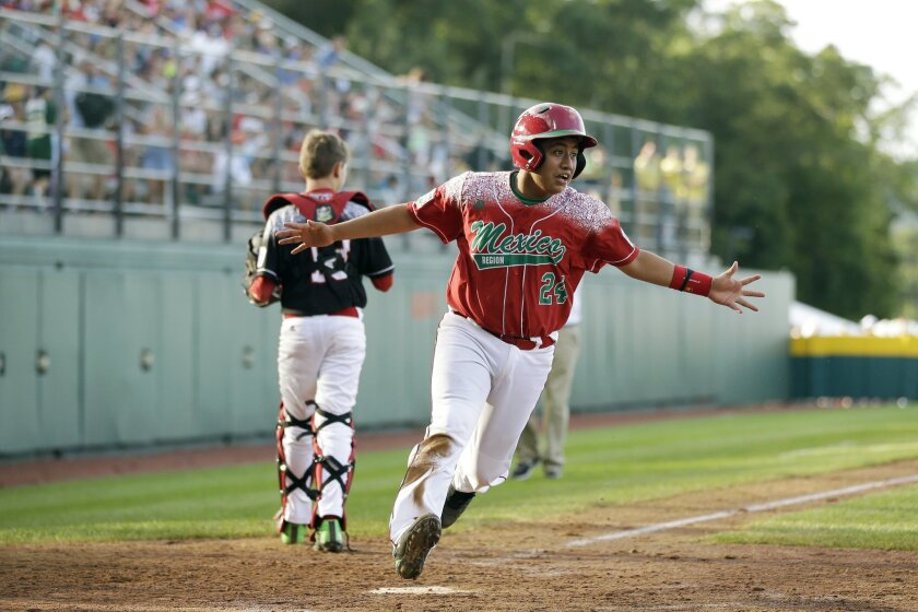 Mexico's Raul Leon celebrates after scoring the game-winning run on a single by Daniel Zaragoza during the sixth inning of an international pool play baseball game against Canada at the Little League World Series, Friday, Aug. 21, 2015, in South Williamsport, Pa. Mexico won 1-0. (AP Photo/Matt Slocum)