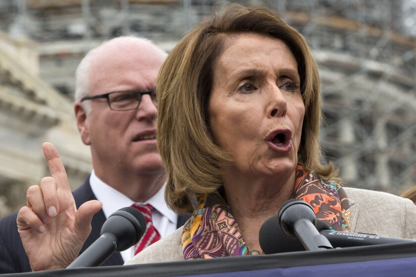 Rep. Joseph Crowley (D-N.Y.) listens as House Minority Leader Nancy Pelosi (D-San Francisco) speaks during a news conference on Capitol Hill in Washington on Oct. 7 to discuss the looming increase in Medicare Part B premiums for some seniors.