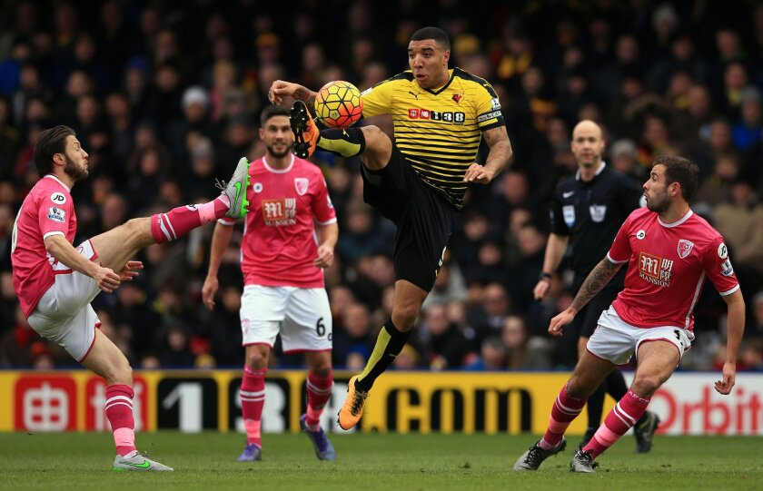Watford's Troy Deeney, centre, and Bournemouth's Harry Arter, left, compete for the ball during the English Premier League soccer match between Watford FC and Bournmouth FC at Vicarage Road,in London. Saturday Feb. 27, 2016. (John Walton /PA via AP) UNITED KINGDOM OUT - NO SALES - NO ARCHIVES