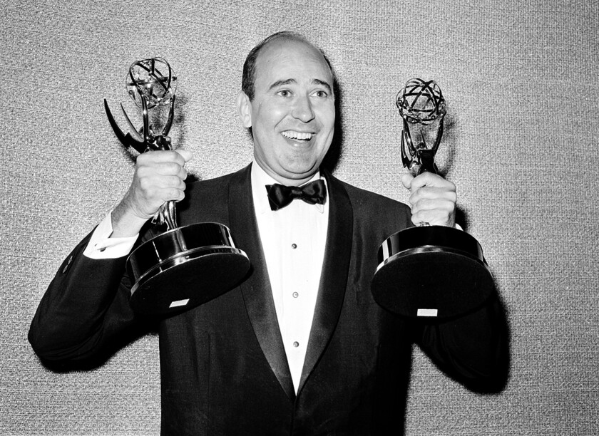 Carl Reiner shows holds two Emmy statuettes
