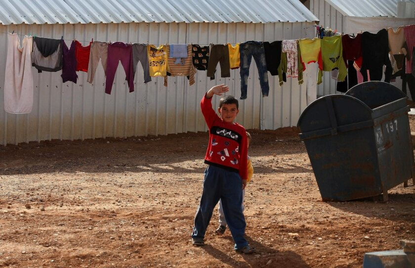 A Syrian child gestures at Azraq Syrian refugee camp in Jordan on Jan. 30.