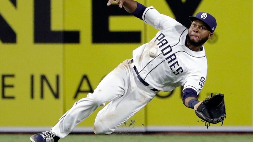 Padres center fielder Manuel Margot makes the catch for the out on New York Mets' Michael Conforto during the fifth inning of a baseball game Wednesday, July 26, 2017, in San Diego.