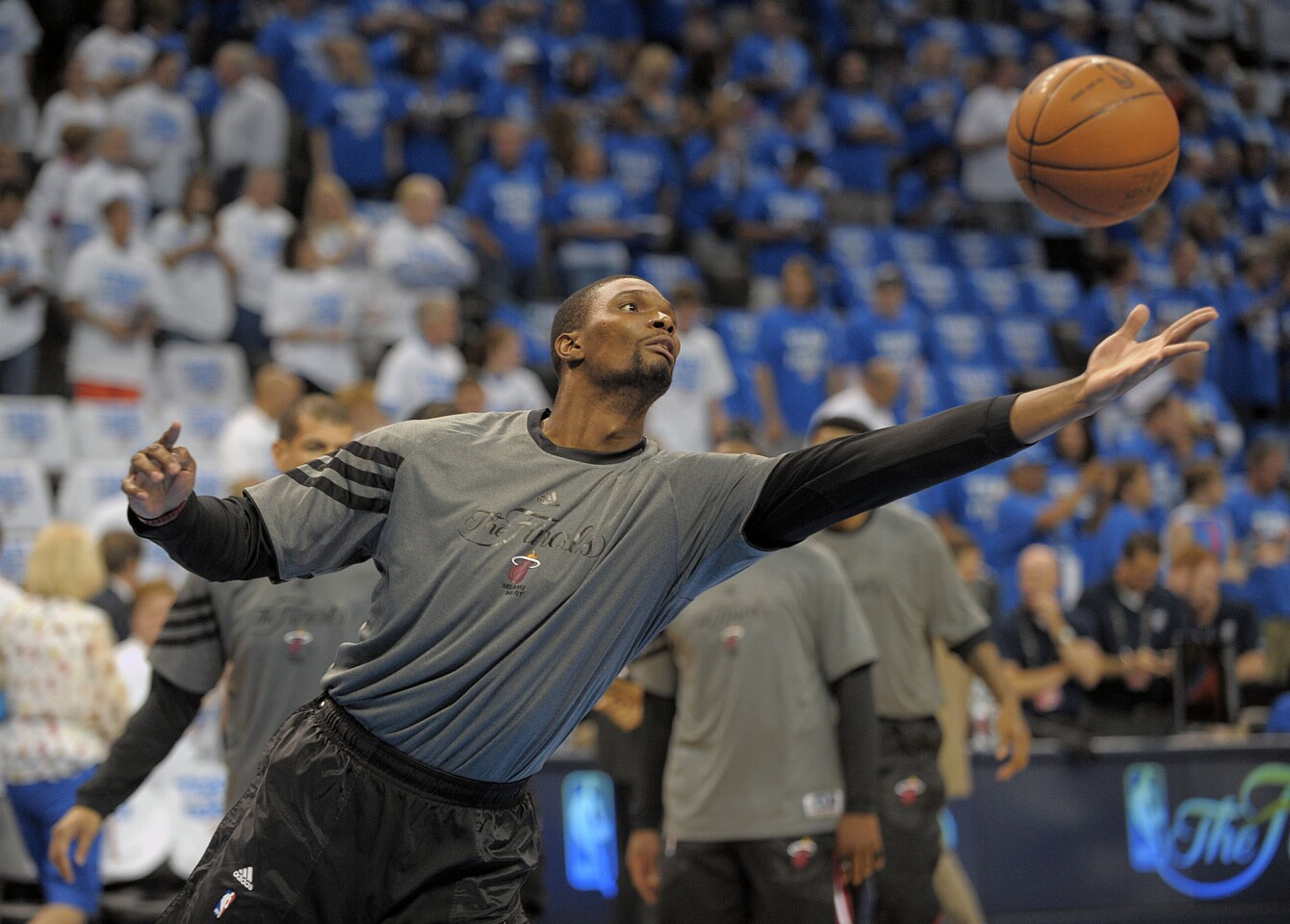 Miami Heat forward Chris Bosh reaches for a rebound during warm-ups for Game 2 of the NBA Finals at Chesapeake Energy Arena.