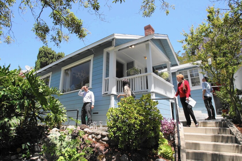 Real estate-related jobs have risen significantly in California as demand for commercial buildings and apartments has boomed. Above, an open house in Highland Park draws a steady stream of visitors in 2012.