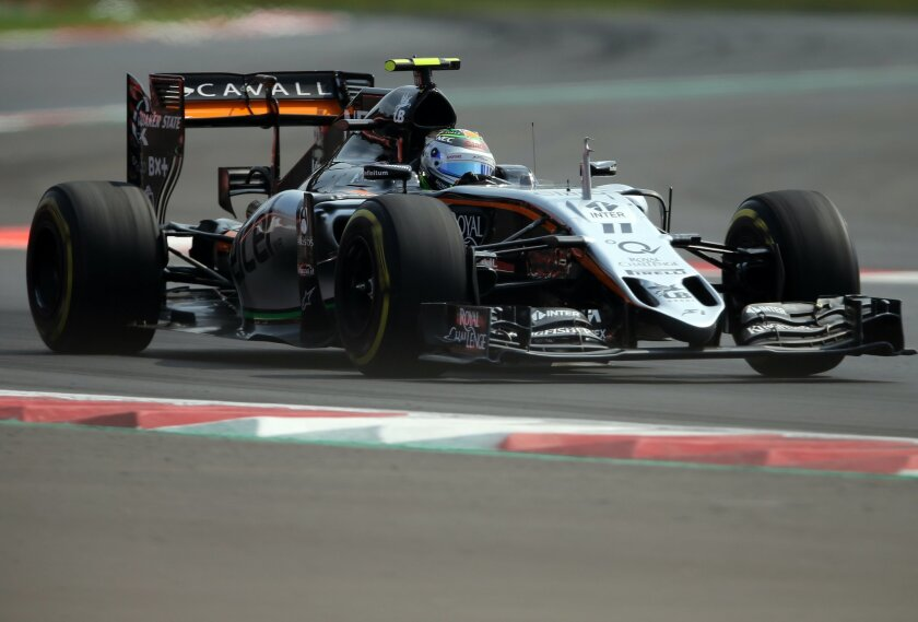 Force India driver Sergio Perez of Mexico steers his car during the Formula One Mexico Grand Prix auto race at the Hermanos Rodriguez racetrack in Mexico City, Sunday, Nov. 1, 2015. (AP Photo/Christian Palma)