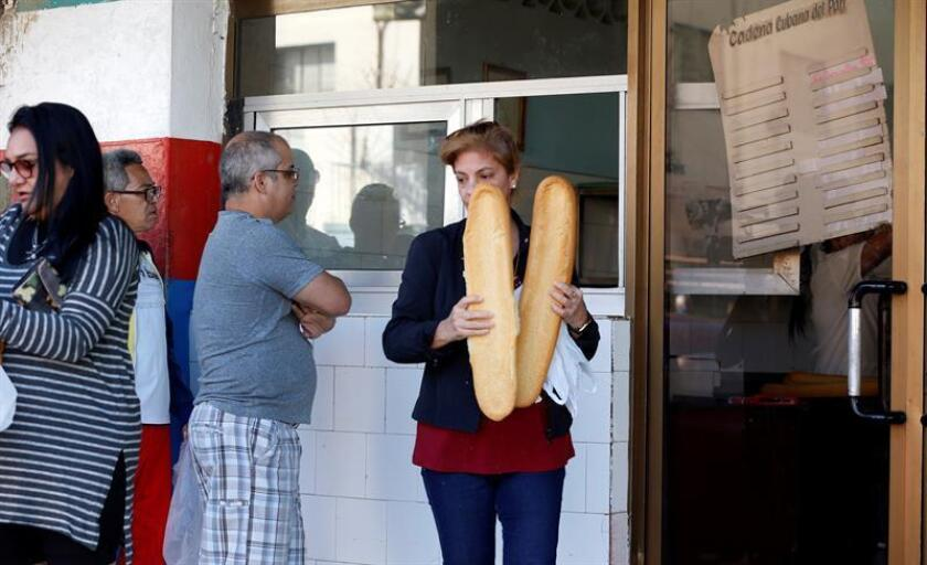 Photo taken Dec. 12, 2018, showing people waiting to buy bread at a Havana bakery. Bread is the latest food item to be in short supply on the communist island. EFE-EPA/Ernesto Mastrascusa