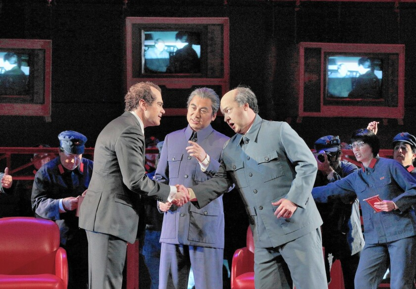 "Baritone Franco Pomponi is Richard Nixon, left, baritone Chen-ye Yuan is Chou En-Lai, and tenor Chad Shelton is Mao Tse-Tung in San Diego Opera's ""Nixon in China."""