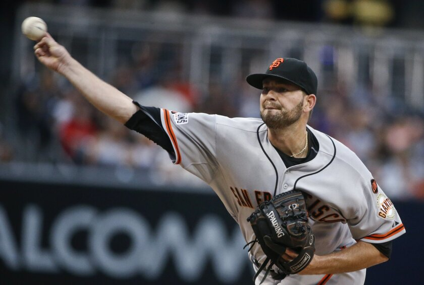 San Francisco Giants starting pitcher Chris Heston works against the San Diego Padres during the first inning of a baseball game Tuesday, July 21, 2015, in San Diego. (AP Photo/Lenny Ignelzi)