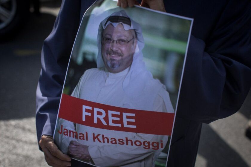 Protesters hold posters of Saudi journalist Jamal Khashoggi at the entrance to the Saudi Arabia Consulate on October 5, 2018 in Istanbul, Turkey.