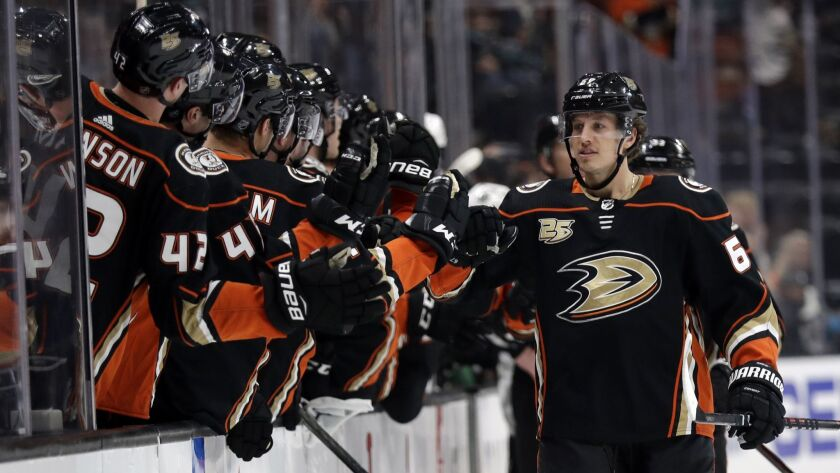 Ducks' Rickard Rakell, right, celebrates his goal with teammates during the first period on Friday.