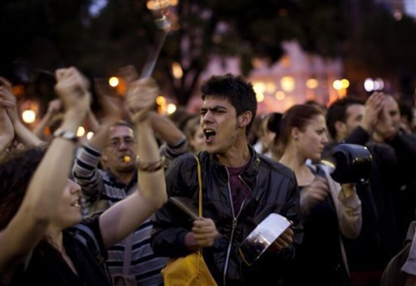 Demonstrators shout slogans as they protest during a rally in Barcelona, Wednesday, May 18, 2011. Spanish university students and youth groups were protesting against a youth unemployment rate of 40 percent and austerity measures taken to end Spain's debt crisis. (AP Photo/Emilio Morenatti)