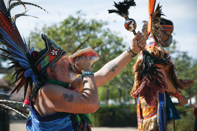 Members of Danza Mexi'cayotl perform in front of the Chula Vista City Hall