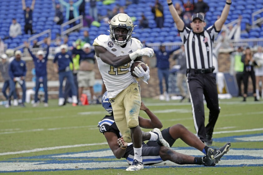 Georgia Tech wide receiver Adonicas Sanders (12) starts to celebrate after he caught a pass for what proved to be the winning touchdown against Duke cornerback Jeremiah Lewis (39) during the second half of an NCAA college football game in Durham, N.C., Saturday, Oct. 9, 2021. (AP Photo/Chris Seward)