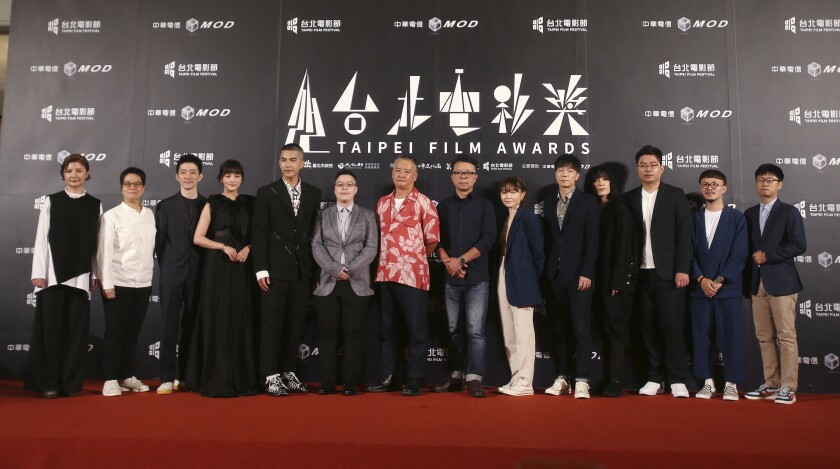 "The team of movie ""Detention"" pose on the red carpet at the 2020 Taipei Film Festival in Taipei, Taiwan, Saturday, July 11, 2020. The 2020 Taipei Film Festival is the world's first large-scale film festival held by an entity after the outbreak of the COVID-19 epidemic. (AP Photo/Chiang Ying-ying)"