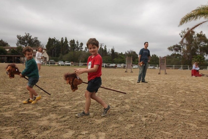 Kids play horse at June's Celebrate Osuna event.