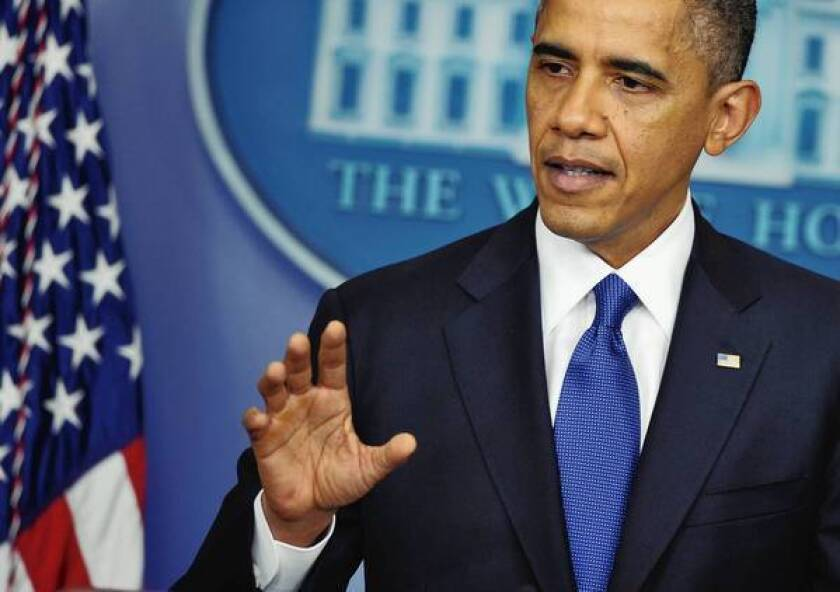 """President Obama, speaking at the White House as """"fiscal cliff"""" talks remain deadlocked, urges Congress to at least prevent tax hikes on incomes under $250,000 and delay major spending cuts due in January."""