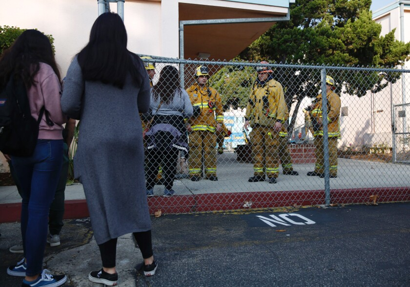 Parents wait outside Park Avenue Elementary School in Cudahy