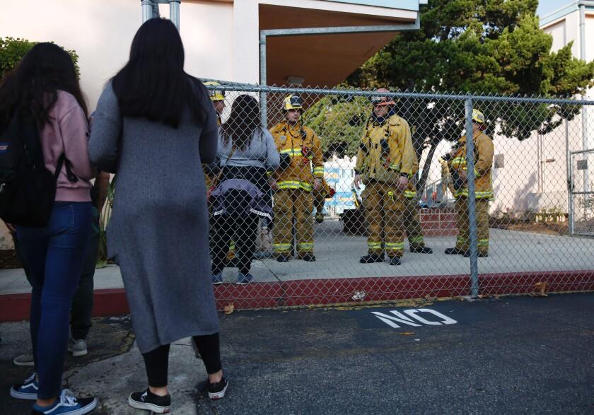 Parents wait outside Park Avenue Elementary School in Cudahy