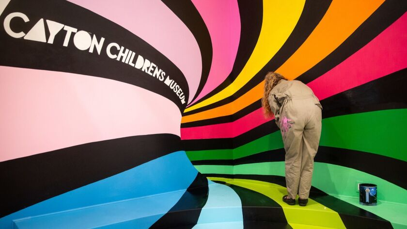 LOS ANGELES, CALIF. - JUNE 13: Artist Stephanie Marra of Redondo Beach works on a painting at the Ca