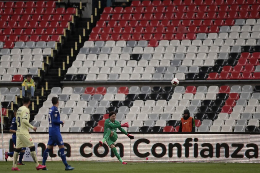America's goalkeeper Guillermo Ochoa kicks the ball during a Mexican soccer league match against Cruz Azul on Sunday in a match played without fans.