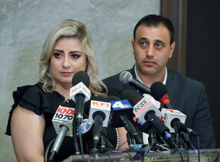 Anni and Ashot Manukyan listen to a question during a press conference to talk about their claim of negligence against the Los Angeles-based CHA Fertility Center at La Plaza de Cultura y Artes in Los Angeles on July 10.