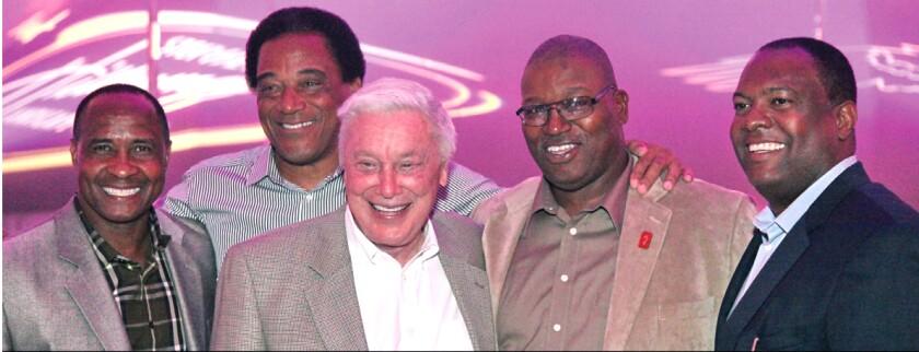 """B. Wayne Hughes with Lynn Swann, Al """"A.C."""" Cowlings, Sam Cunningham and Rodney Peete."""