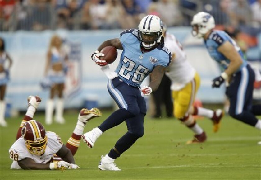 Tennessee Titans running back Chris Johnson (28) gets past Washington Redskins linebacker Brian Orakpo (98) while running 58 yards for a touchdown in the first quarter of a preseason NFL football game on Thursday, Aug. 8, 2013, in Nashville, Tenn. (AP Photo/Wade Payne)
