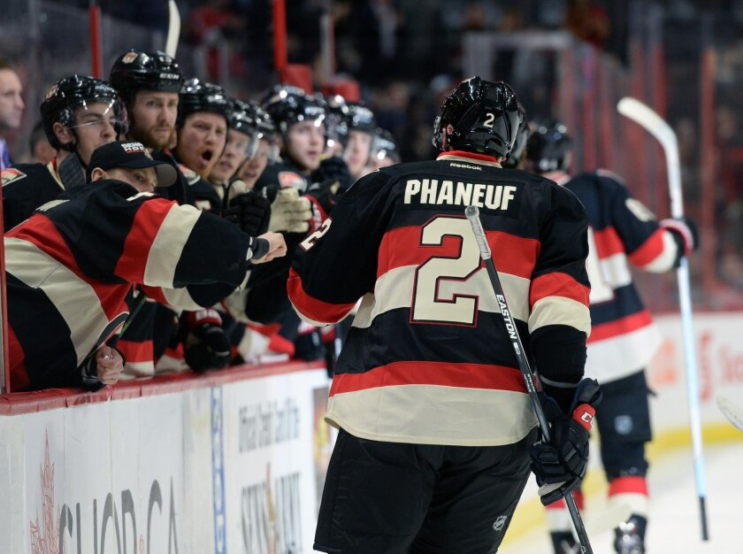 Ottawa Senators' Dion Phaneuf, gets high-fives from his new teammates as he celebrates a goal against the Colorado Avalanche during second period NHL hockey action in Ottawa, Canada, Thursday, Feb. 11, 2016. Phaneuf recorded an assist on the goal. (Sean Kilpatrick/The Canadian Press via AP) MANDATO