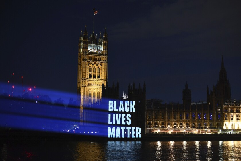 Black Lives Matter is projected onto the Houses of Parliament, in London, Friday, June 5, 2020, as part of the ongoing worldwide demonstrations following the death of George Floyd. Just like the coronavirus, racism has no borders. Across the world, disgruntled people, representing a broad spectrum of society, marched this weekend as one to protest against racial injustices at home and abroad. (Victoria Jones/PA via AP)