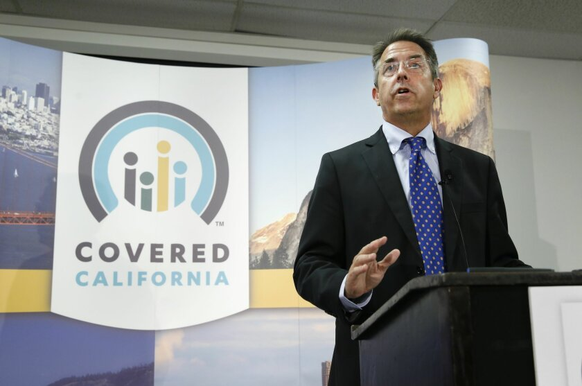 In this photo taken Wednesday, Nov. 13, 2013, Peter Lee, executive director of Covered California, the state's health insurance exchange, announced that nearly 35,000 people signed up for health insurance during the first month of open enrollment, from Oct. 1 through Nov. 2, during a news conferenc