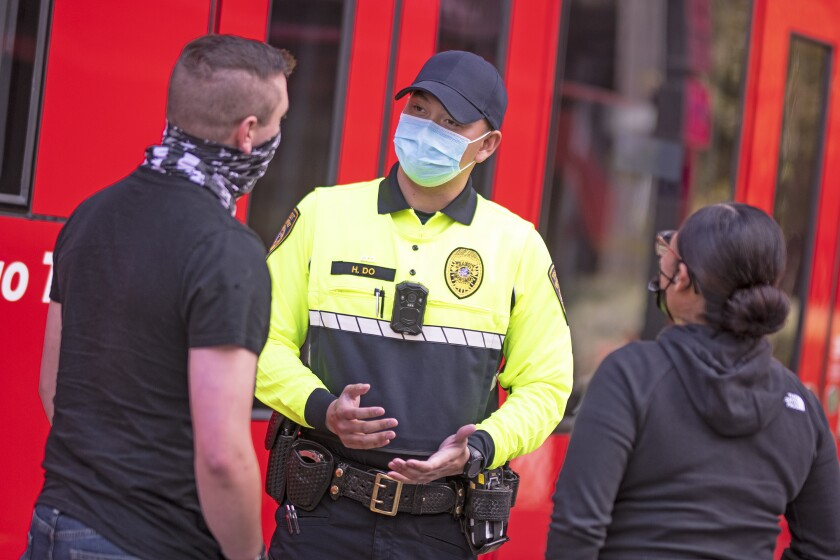 An MTS code compliance inspector wears the agency's new uniform.