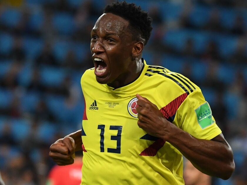 Colombia's defender Yerry Mina celebrates after scoring the equalizer during the Russia 2018 World Cup round of 16 football match between Colombia and England at the Spartak Stadium in Moscow on July 3, 2018.