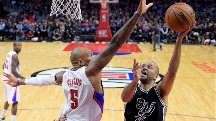 Spurs guard Tony Parker puts up a shot against Clippers center Marreese Speights during the second half of a game on Feb. 24 at Staples Center.