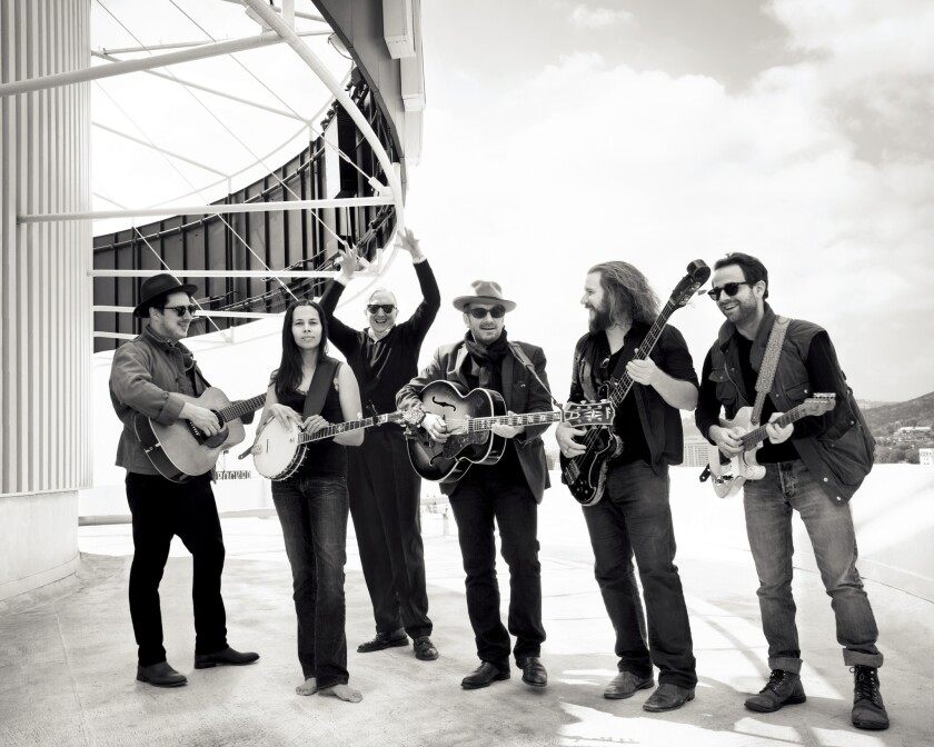 """From left, Marcus Mumford, Rhiannon Giddens, T Bone Burnett, Elvis Costello, Jim James and Taylor Goldsmith in """"Lost Songs: The Basement Tapes Continued."""""""