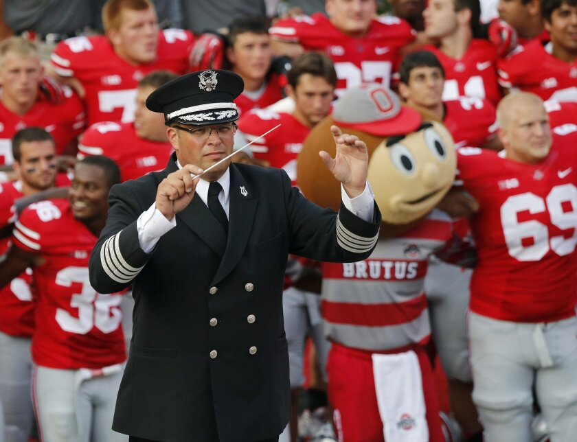 """FILE - In this Sept. 7, 2013 file photo, Ohio State University marching band director Jonathan Waters leads the band in """"Carmen Ohio"""" following an NCAA football game against San Diego State at Ohio Stadium in Columbus, Ohio. An unofficial marching band song that made fun of Holocaust victims is the type of thing Ohio State University has pledged to eradicate from the band program, the university said Thursday, July 23, 2015. Ohio State fired marching band director Waters last year after determining he ignored a """"sexualized culture"""" within the band. (Adam Cairns/The Columbus Dispatch via AP, File) MANDATORY CREDIT"""