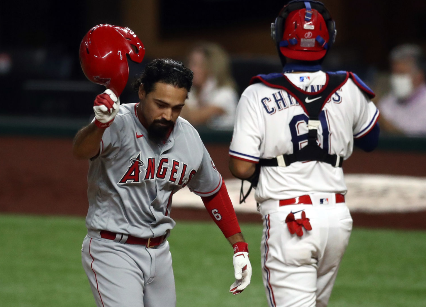 Angels third baseman Anthony Rendon throws off his helmet after striking out against the Texas Rangers.