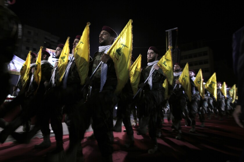 Hezbollah fighters marching at a rally in Beirut