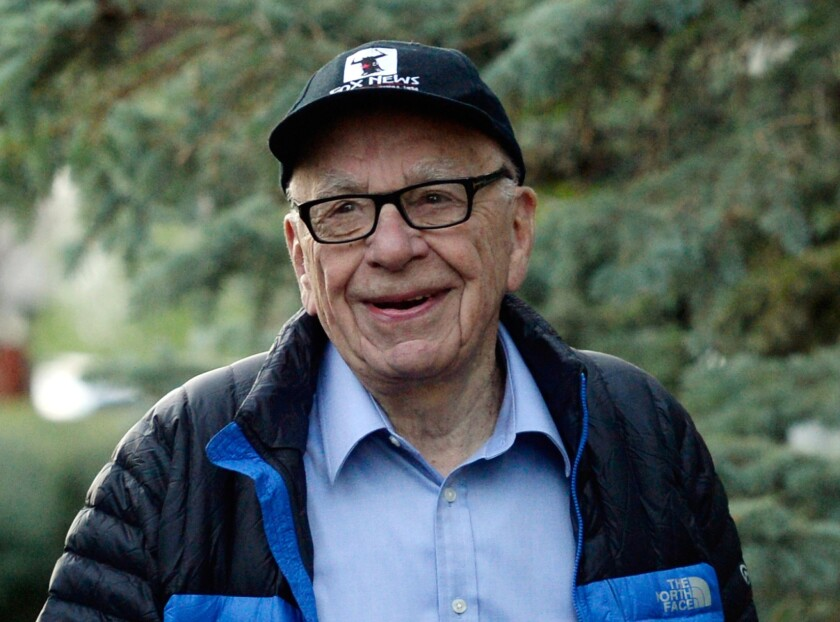 Rupert Murdoch's publishing company News Corp. said Thursday it would pay shareholders a semiannual cash dividend, its first since becoming a stand-alone company in 2013. Murdoch, who is chairman of News Corp., is pictured here in Sun Valley, Idaho, in July 2013.