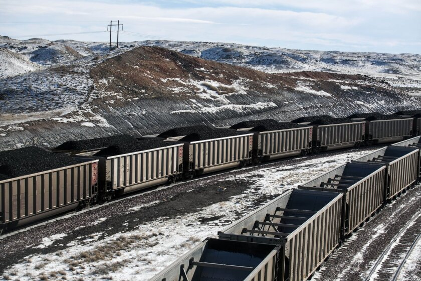 Rail cars filled with coal sit outside Antelope Mine in 2014.