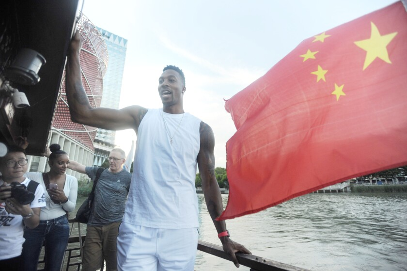 Dwight Howard stands on a boat at East Lake Scenic Area while visiting Wuhan, in the Hubei Province of China in September 2018.