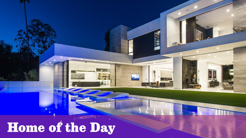 A 100-foot infinity-edge pool is among the lavish features at the newly built contemporary home in Beverly Hills.