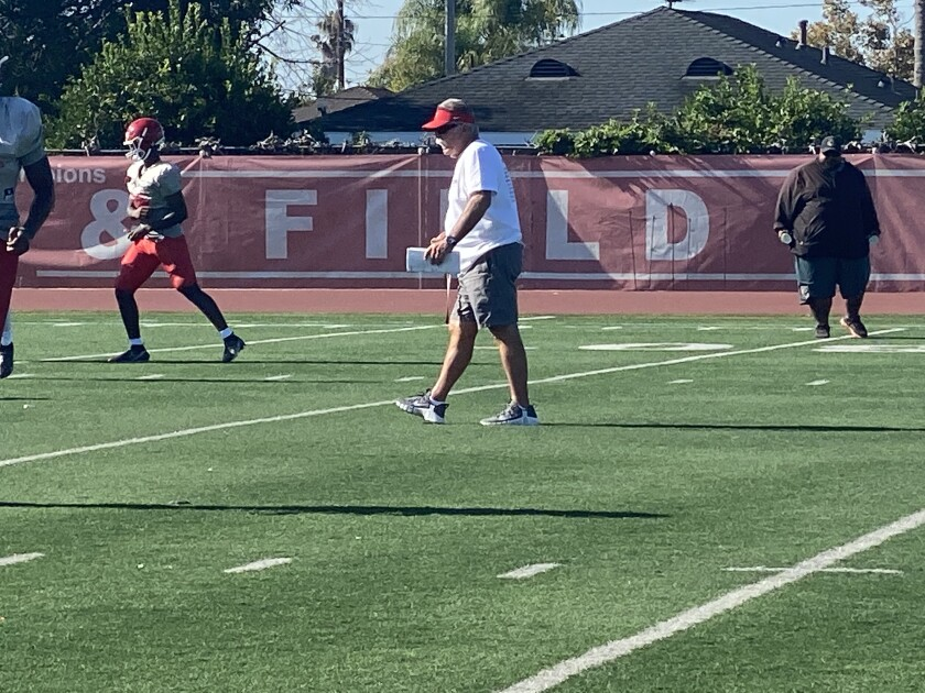 Mater Dei coach Bruce Rollinson during practice this week. He's trying to find out about NIL rules for his top athletes.