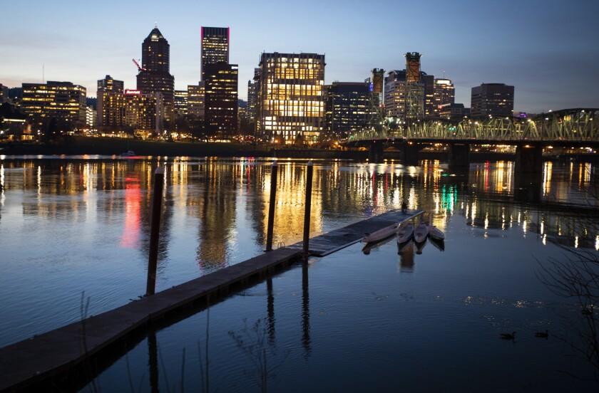 A river, a bridge and a city in the dark