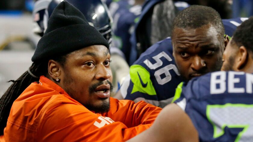 New Oakland Raiders running back Marshawn Lynch chats on the sideline during this 2014 game while with the Seattle Seahawks.