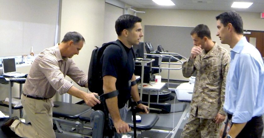 Derrek Herrera learns how to walk again after being paralyzed from the chest down while on patrol in Afghanistan.