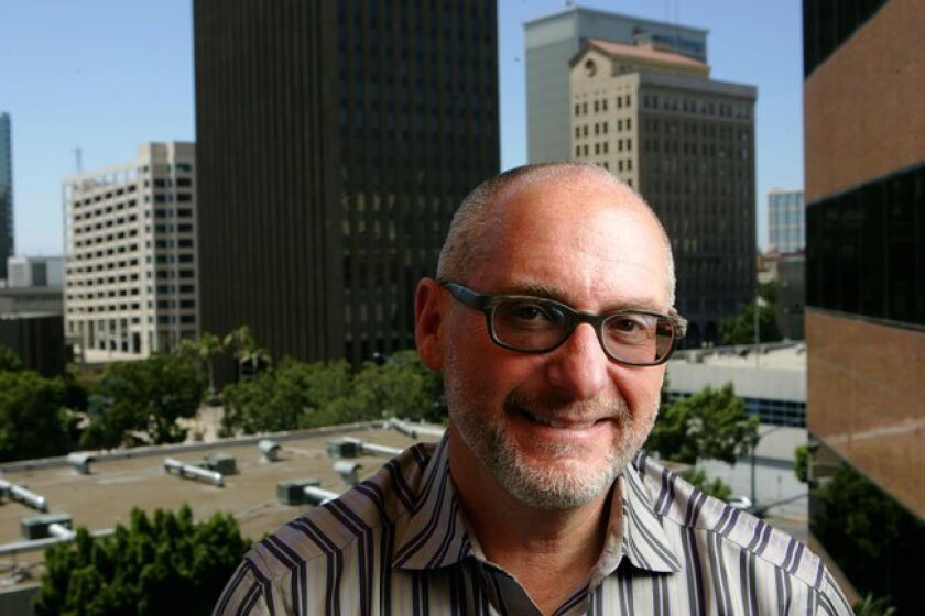 Fred Maas, chair of the Center City Development Corporation, stands in front of downtown buildings on Wednesday, August 4, 2010 in San Diego.